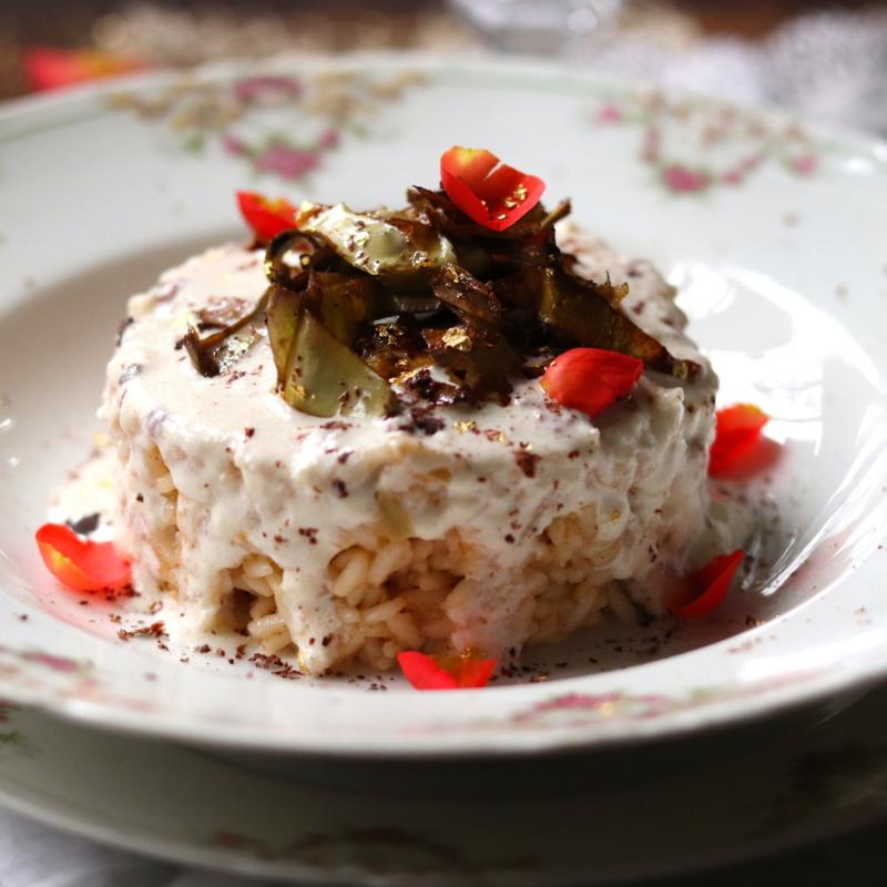 Timballo di riso con carciofi, fonduta di Castelmagno e cioccolato piccante